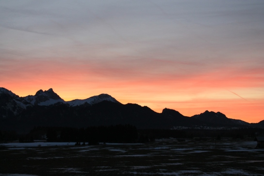 Sunsets over mountains
